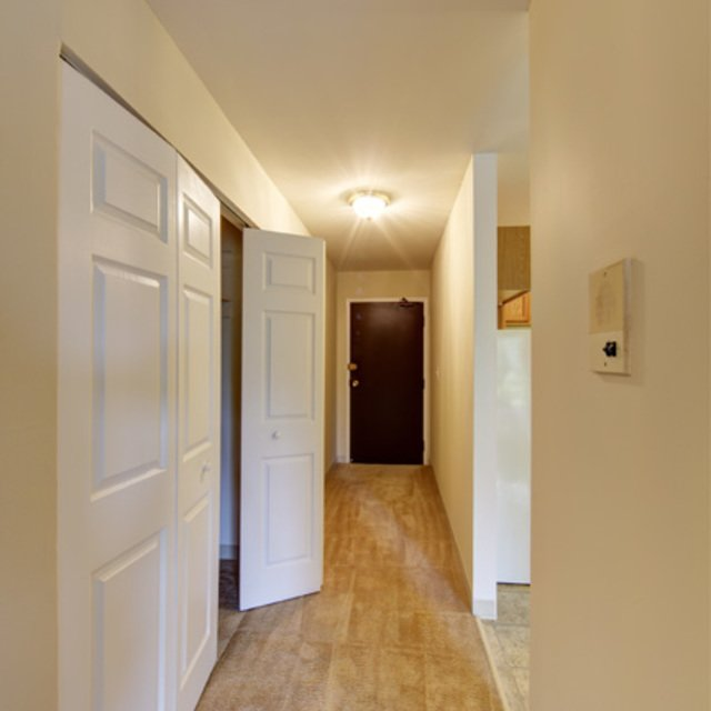 Rosewood Apartments - Beige Carpet Hallway