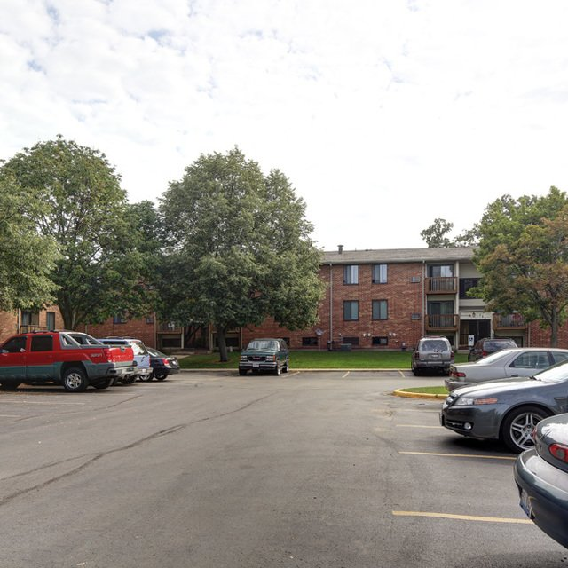 Rosewood Apartments - Cars in a Parking Area