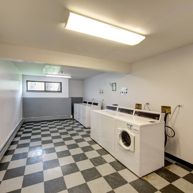 Rosewood Apartments - Convenient Laundry Area