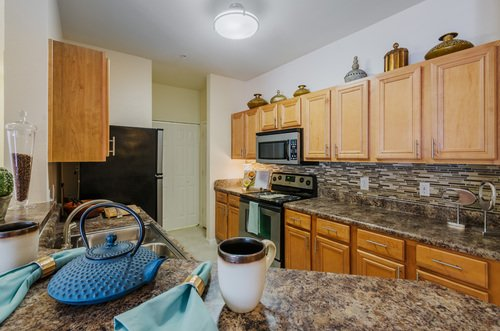 Tradition at Stonewater Apartments - Kitchen with Wood Cabinets
