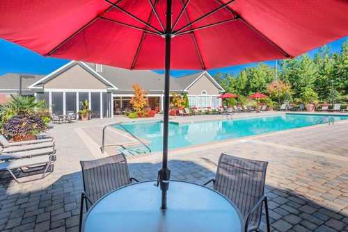 Tradition at Stonewater Apartments - Pool Seating with Umbrella